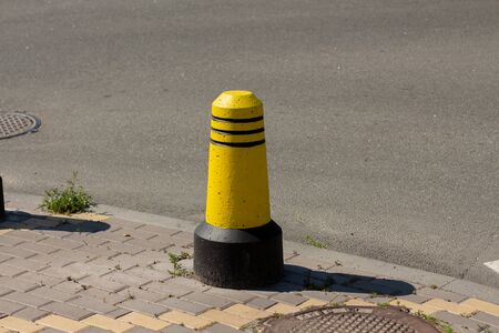 a boundary posts on the sidewalk