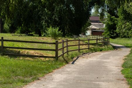 an old wooden fence in the meadow