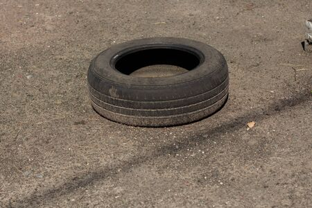 a old car tire on asphalt