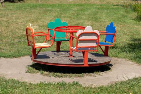 a children's carousel in the park Standard-Bild
