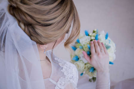 the bride's hand on the a wedding bouquet