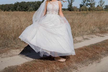 bride in a wedding dress in field 写真素材