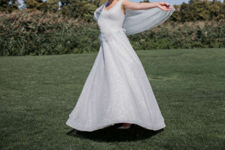 bride in on golf course and green grass
