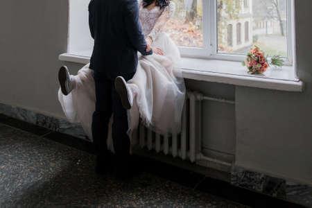 bride and groom in sneakers at wedding