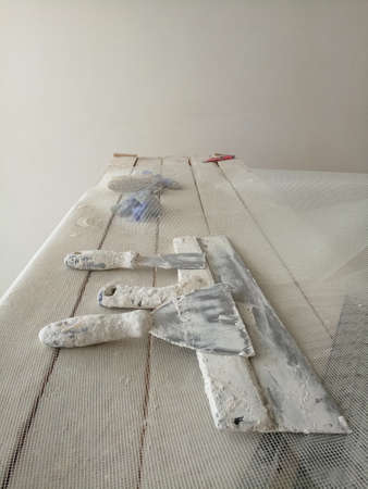spatula for painters on wooden chair