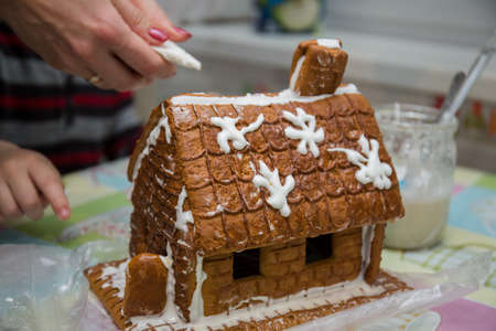 making a gingerbread house on kitchen table