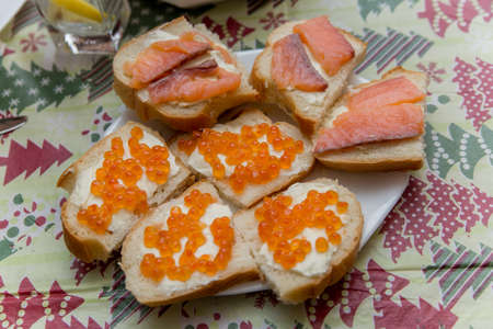 a sandwiches with red caviar on the festive table