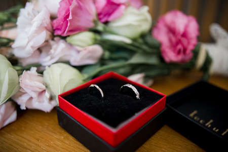 a wedding rings in a box with flowers