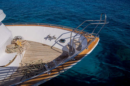 bow of a beautiful yacht on sea water