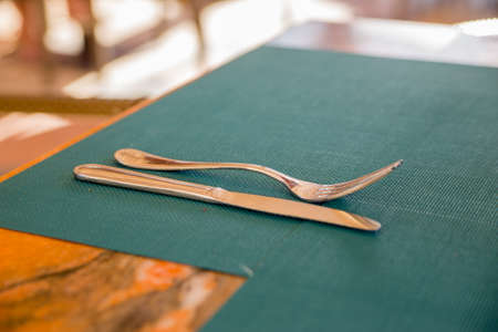 a knife and fork on an empty table