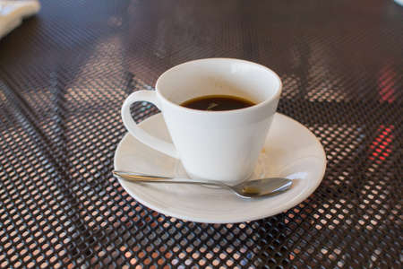 a cup of coffee on the table in coffee shop
