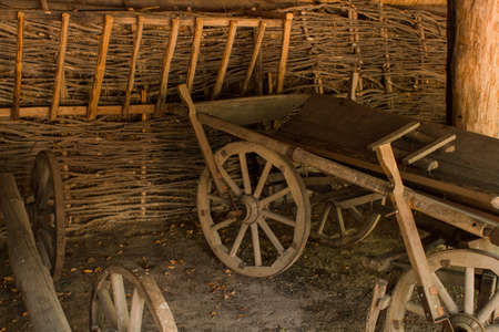 old wooden cart in barn with straw
