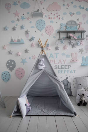 gray wigwam in the children's a room