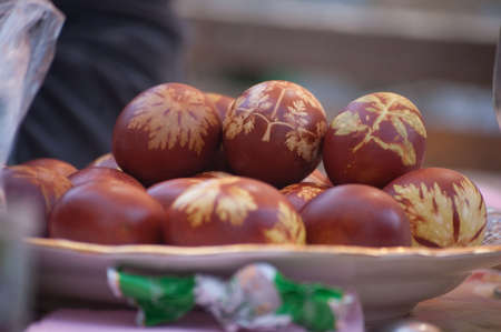 Easter eggs with leaf patterns on table