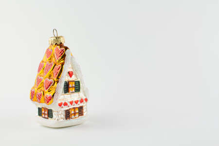 a toy house for the tree on a white background