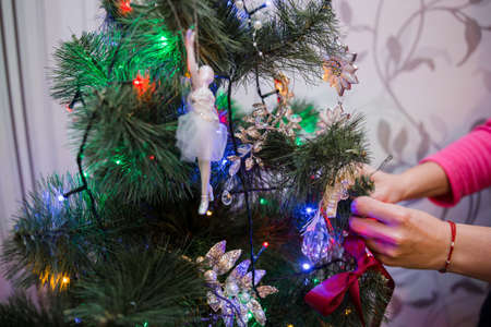 a beautiful toys on the christmas tree with garland Standard-Bild