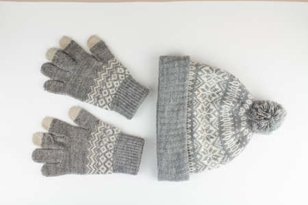 women's winter knitted mittens with a hat on white background