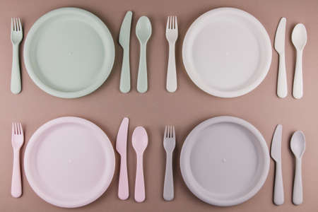 a table setting in a restaurant for four persons with a plate spoon fork knife