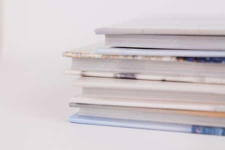 a books are in a pile on top of each other on a white background