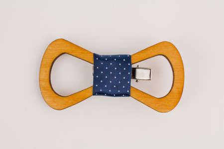 a wooden bow tie on a white background for a suit beautiful and stylish Foto de archivo