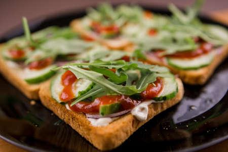 a delicious rocket salad sandwiches on a plate Standard-Bild
