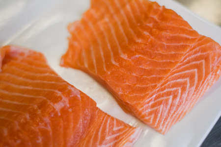 a large pieces of fresh salmon on the table Standard-Bild