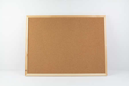 a cork board for notes on white background