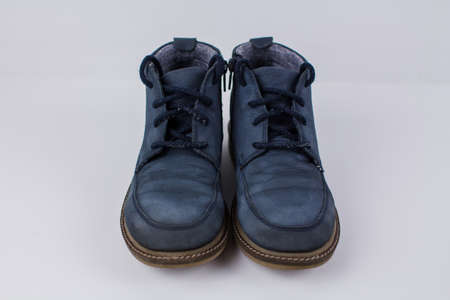 a winter blue boots on a white background
