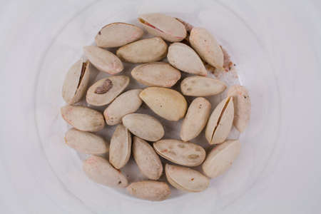 last closed pistachios in a pack on a white background Banque d'images