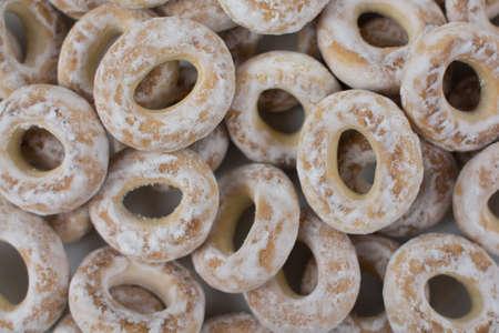 a white bagels in powdered sugar background baking