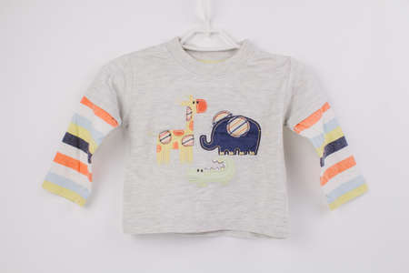 a children's blouse for baby on a white background Banque d'images