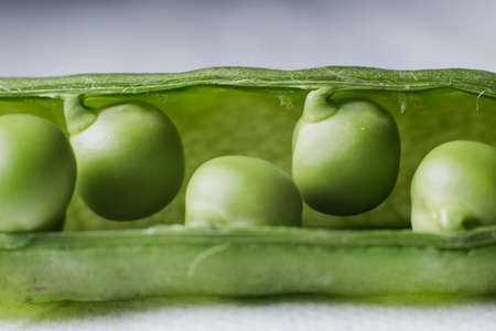 a fresh young green peas in a close-up food background