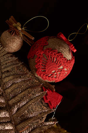 Handmade Christmas decorations: vintage New Year tree toys on a warm wooden background. Cristmas and New Year concepts.