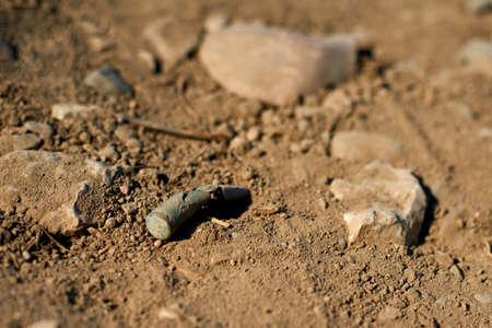 Corroded gun sleeve in desert. Horror of war concept. Stock Photo