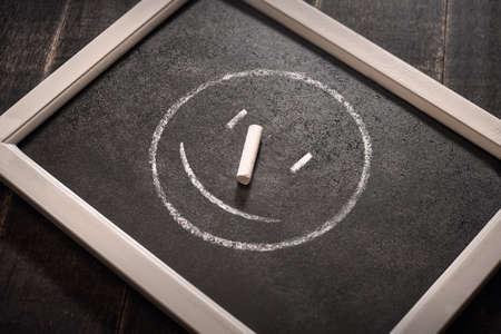 Modern smile icon black background, chalk board.