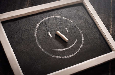 Modern smile icon black background, chalk board.