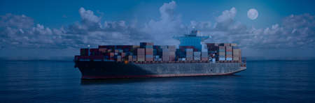 Mighty container ships in ocean at night underway performing import and export marine cargo transportation. Commercial goods industry and maritime cargo shipment concept.