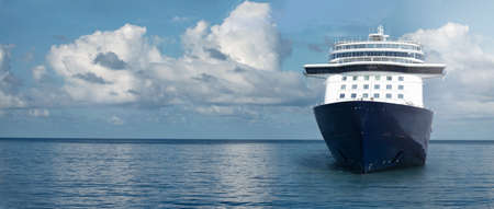 Seascape banner of cruise passenger ship in the middle of the ocean. Luxury cruise travel concept.