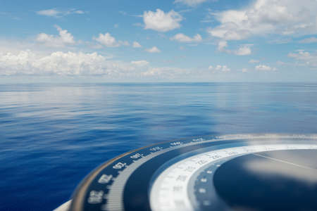 Compass on ship boat blue summer sea ocean day with bright sky. Marine cruise background banner.Shipping industry concept.