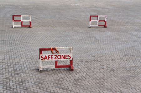 Safety zone sign on a dockyard. Protection and safety concept.