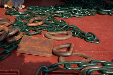 Cargo lashing chains, stoppers and d-rings deck of merchant cargo ship ready for cargo securing