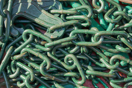 Cargo lashing chains on deck of merchant cargo ship ready for cargo securing