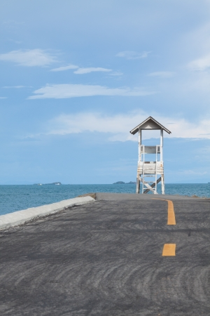 The road to lifeguard house at the end of shore photo