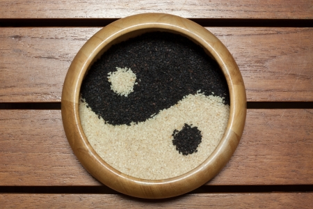 Yin Yang black and white sesame in wooden bowl