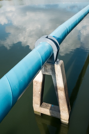 A big pvc pipe over the pond photo