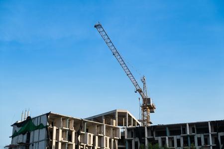 Crane and building progress at construction site