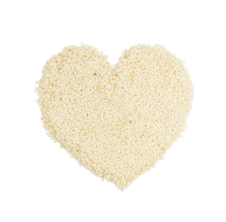 Heart shape from white sesame seed isolated on white with clipping path