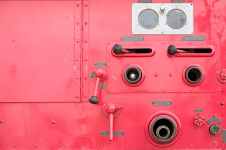 antique fire truck: Valve control of fire engine truck look like human face with copyspace Stock Photo