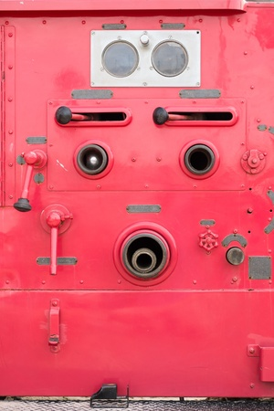 antique fire truck: Valve control on fire engine truck look like a human face