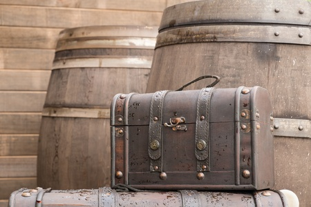 Brown vintage leather bag with wooden barrel background Stock Photo - 22118613